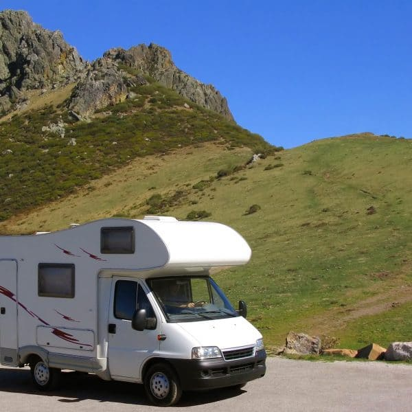 motorhome parked near a hill