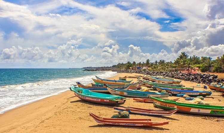 fishing boats on a beach in Pondicherry